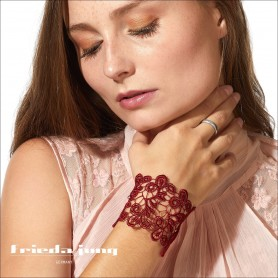 Embroidered lace bracelet in Red by Frieda Jung. Buy Online.